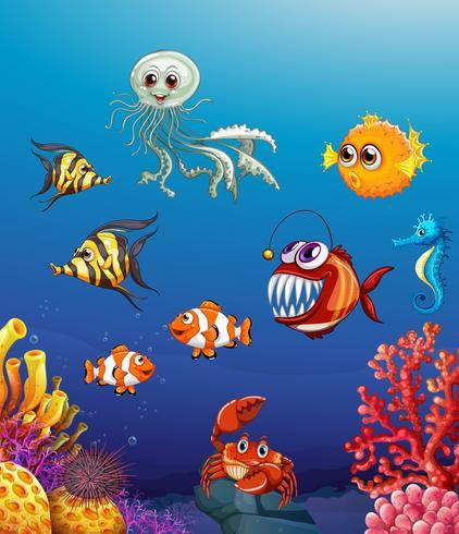 Scena con animali marini sotto l'oceano vettore