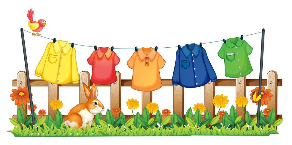 Un giardino con vestiti appesi e un coniglio vettore