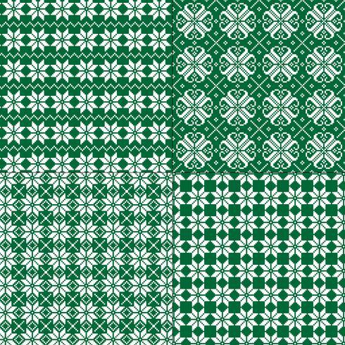 modelli di fiocchi di neve nordici verdi e bianchi vettore