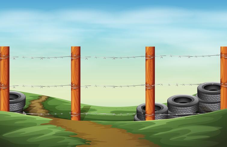 Un recinto di filo spinato vettore