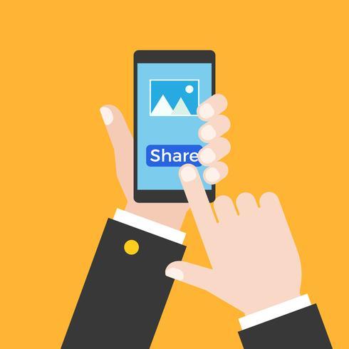 mano di affari che tiene smart phone e touch screen per condividere foto vettore