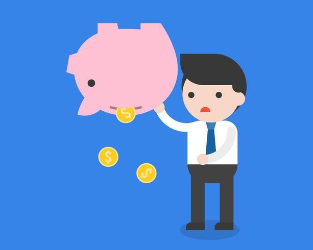 Uomo d'affari che porta le monete di oro e del porcellino salvadanaio, fallimento che risparmia concetto dei soldi vettore
