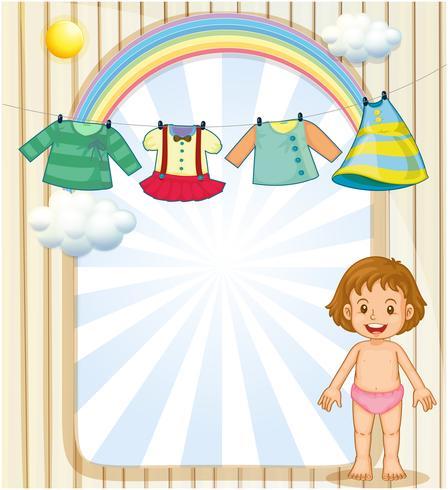 Un bambino sotto i vestiti appesi vettore