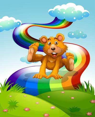 Un orso bruno giocoso saltando vicino all'arcobaleno vettore