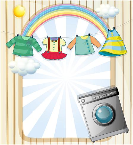 Una lavatrice con vestiti appesi in cima vettore