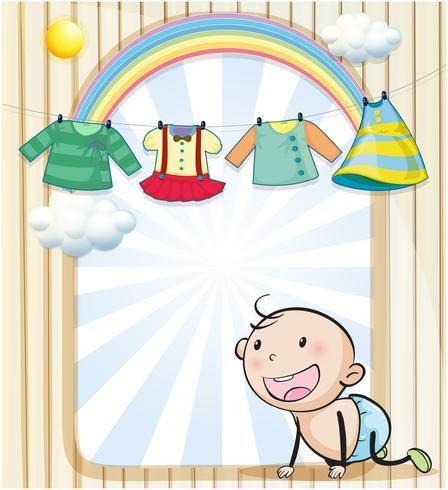 I vestiti di una bambina sono appesi vettore