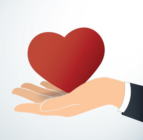 mano che tiene il vettore di cuore