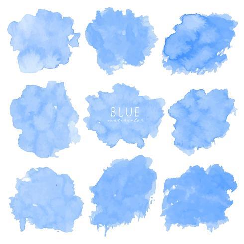 Insieme dell'acquerello blu su fondo bianco, acquerello del colpo della spazzola, illustrazione di vettore. vettore