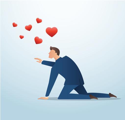 uomo che cerca di catturare l'icona del cuore rosso, l'uomo tenta di trovare l'amore vettore