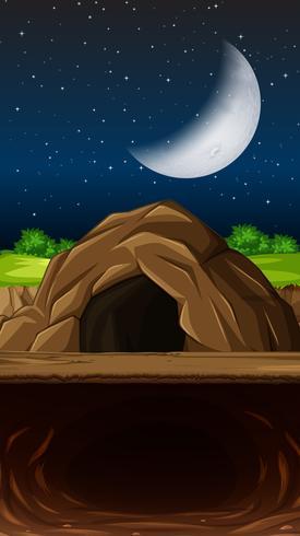Una grotta in scena nigth vettore
