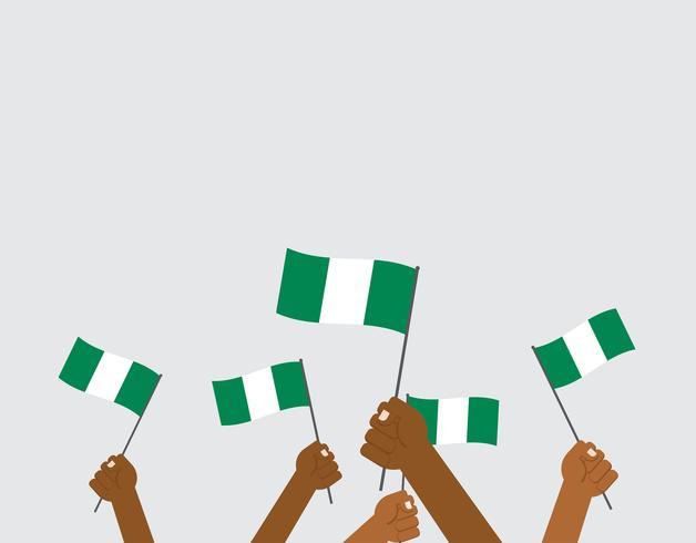 Illustrazione vettoriale mani che tengono le bandiere della Nigeria isolato su sfondo