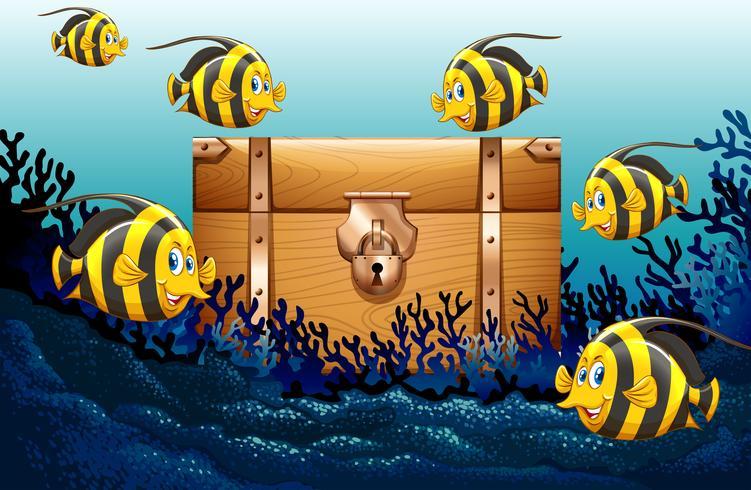Pesce che nuota sotto l'oceano vettore