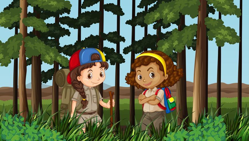 Due ragazze che fanno un'escursione nella giungla vettore