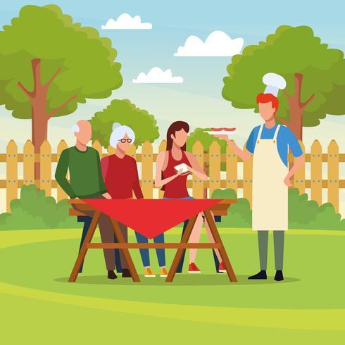 Picnic in famiglia con barbecue vettore