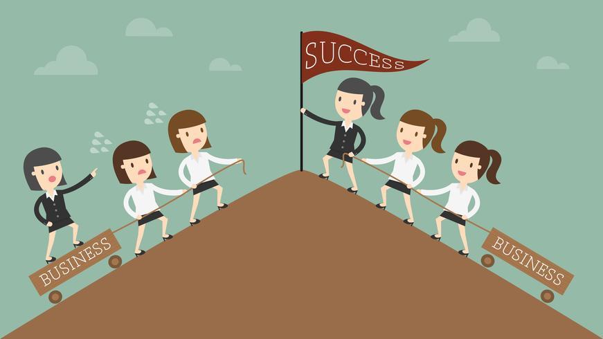 Donne d'affari che raggiungono l'obiettivo vettore