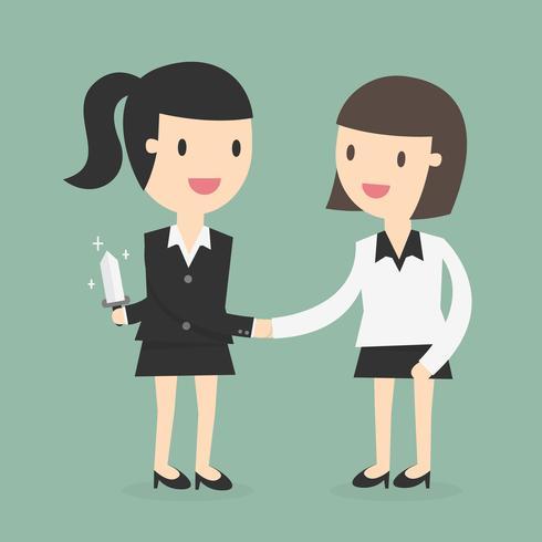 Handshake dei soci commerciali mentre uno tiene il coltello dietro la schiena vettore