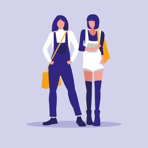 Due ragazze pronte per la scuola vettore