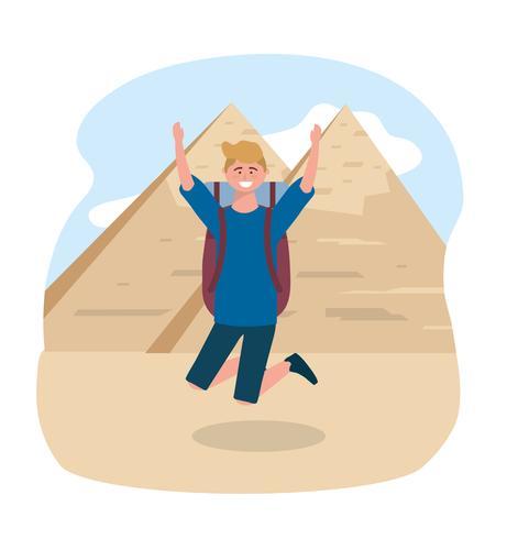 Turista maschio che salta davanti alla piramide egiziana vettore