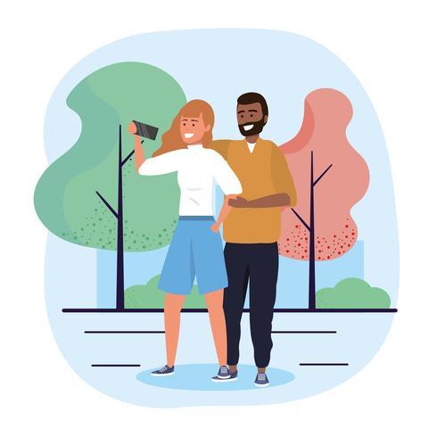 Uomo e donna che prendono selfie nel parco vettore