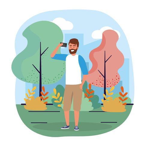 Giovane uomo urbano con la barba con lo smartphone nel parco vettore