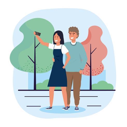 Uomo e donna che prendono selfie vettore