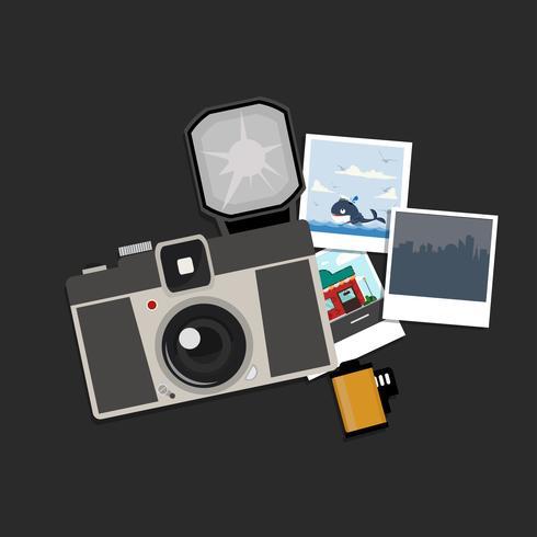 Fotocamera con foto e pellicola vettore