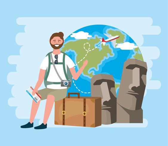 Turista maschio che si siede sulla valigia con le statue e il globo dell'isola di pasqua vettore
