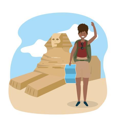 Donna afroamericana davanti alla sfinge egiziana vettore