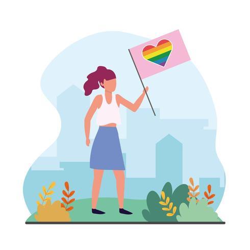 donna con bandiera arcobaleno cuore alla celebrazione lgtb vettore