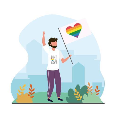 uomo con bandiera arcobaleno cuore alla celebrazione lgtb vettore