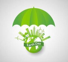 ombrello verde sopra il globo della giornata della terra con paesaggio urbano