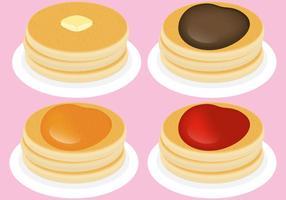Pancakes con condimenti vettore