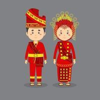 coppia indossa abito tradizionale rosso, oro sumatra occidentale