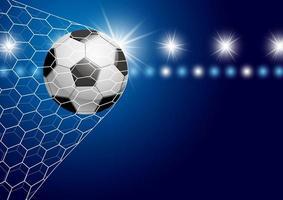 pallone da calcio in porta sul blu