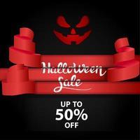 vendita di Halloween con manette rosse e faccia di zucca