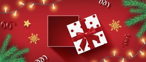 banner di Natale con presente aperto, fiocchi di neve e coriandoli