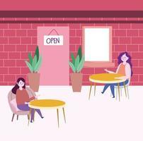 donne che si allontanano socialmente nel ristorante