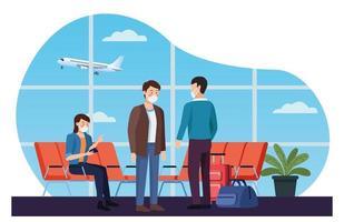 alcuni viaggiatori che utilizzano mascherina medica in aeroporto