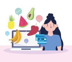 donna con generi alimentari di acquisto del computer portatile in linea vettore