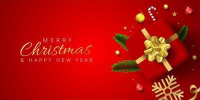banner di Natale rosso con regalo, palline, fiocco di neve, foglie di pino