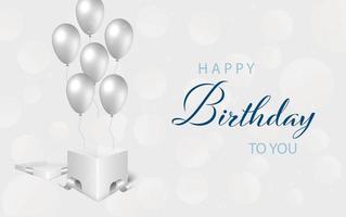 scritta di buon compleanno con palloncini d'argento e regalo