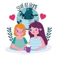 giovane coppia con scritta stay at home