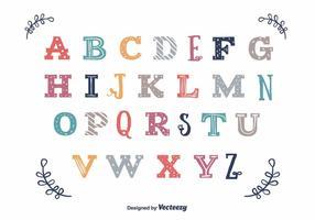 Vettore di alfabeto vintage colorato