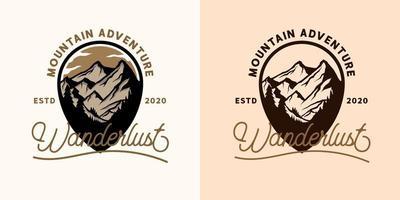 design t-shirt emblema di avventura in montagna