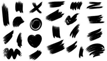 set di pennellate disegnate a mano nera vettore