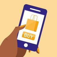mano e smartphone con lo shopping online