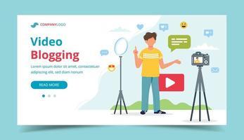 video blogger che registra video con fotocamera e luce