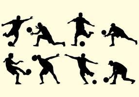 Silhouette di giocatori di Kickball vettore