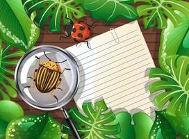 vista dall'alto del tavolo con carta, insetti e fogliame