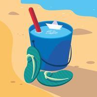 secchio di sabbia in spiaggia